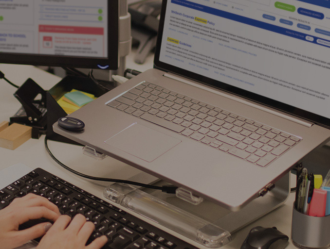 A WHSmith staff member using the WHSmith intranet on a laptop.